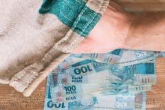 Brasilianska pengar, reais/på den bankpåsen/affärsidéen Arkivbilder