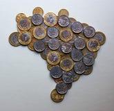 Brasilien översikt med mynt Fotografering för Bildbyråer