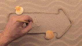 Brasilien-Aufschrift eigenhändig geschrieben auf den Sand, in den Zeiger gemacht vom Seil stock footage
