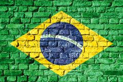 Brasilien-Staatsflagge gemalt auf einer Backsteinmauer Stockfotos