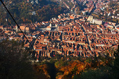 City from above. Brasov city seen from above. Cable car lines descending Stock Photography