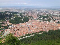 Brasov city. Seen from the mountain Tampa along with a female taking a picture of it Royalty Free Stock Photos