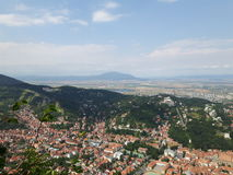 Brasov city. Seen from the mountain Tampa along with a female taking a picture of it Stock Photography
