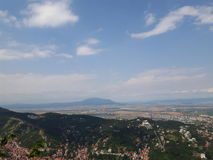 Brasov city. Seen from the mountain Tampa along with a female taking a picture of it Royalty Free Stock Photography