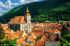 Brasov cityscape in Romania. Brasov cityscape with black cathedral and mountain on backround in Romania royalty free stock image