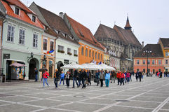 Brasov council square with tourists Stock Photos
