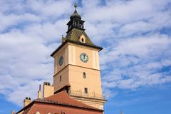 Brasov County Museum of History clock tower. Blue sky with clouds. Romania tourist spots royalty free stock photos