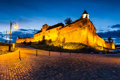 Brasov Fortress at night, Romania. Twilight with Brasov Hill Fortress, part of the city outer fortification system. Stone Citadel was built in 1553 for Royalty Free Stock Photo