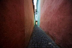 Brasov - Narrow Street. Strada Sforii(Rope Street) in Brasov is one of the narrowest streets in Europe. Its width varies between 111 and 135 centimeters, and it stock image