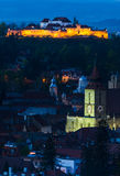 Brasov night cityscape in Romania. Nightview of Brasov city in Transylvania, Romania, with Black Church and medieval Fortress Royalty Free Stock Images
