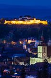 Brasov night cityscape in Romania. Nightview of Brasov city in Transylvania, Romania, with Black Church and medieval Fortress Stock Images