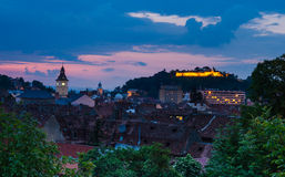 Brasov, old city, dusk hour image. Medieval downtown of Brasov, at twilight time, one of the most preserved old cities in eastern Europe. The city is in Stock Photos
