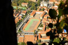 Brasov Old City and sports high school. Autumn view from above Tampa Mountain. The high school is surrounded by 18th-19th century houses, most of which are stock photos
