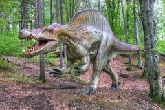 BRASOV, ROMÊNIA - EM JUNHO DE 2015: dinossauros Real-feitos sob medida em Rasnov Dino Imagens de Stock Royalty Free