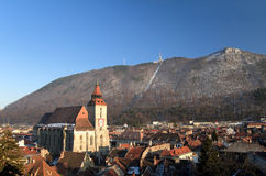 Brasov - Romania. Braşov is located in the central part of Romania, about 166 km north of Bucharest. It is surrounded by the Southern Carpathians and is part of Royalty Free Stock Images