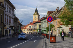 Brasov, Romania -  April 29, 2014: Street of old town with town Royalty Free Stock Photography