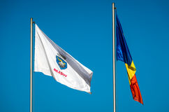 Brasov and Romania Flags. Bra?ov and Romania Flags against a blue sky in the Transylvania region stock images