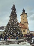 Council Square during winter holidays, Brasov, Romania royalty free stock image