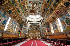 Orthodox church in Brasov. Brasov, Romania, July 2019: The inside of The Biserica schimbarea la fata Transfiguration Cathedral. View angled to ceiling stock photos