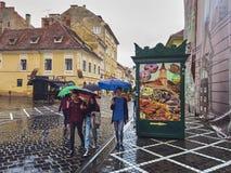 Rainy city break in Brasov, Romania stock photos