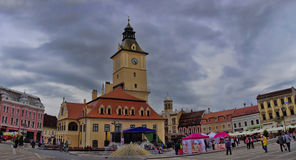 BRASOV, ROMANIA - JUNE 18, 2014: Tourists visit old town of Bras Royalty Free Stock Photo