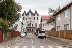 Alexandru Odobescu Street and Orthodox Church of the Holy Emperors Constantine and Helena in the Brasov city in Romania. Brasov, Romania, October 06, 2017 Royalty Free Stock Photography