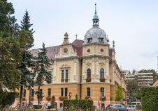 Building of Metropolitan Agency near to the Old Town of Brasov in Romania Royalty Free Stock Image