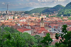 Landmark attraction in Brasov, Romania. Panorama over the old town with the Council Square and the new town in background Royalty Free Stock Image