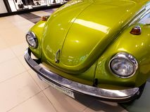 Green, retro Volkswagen Beetle at the local mall. stock photos