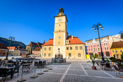 Brasov, Romania. Brasov, Transylvania, Romania. Sunrise scenery with Main Square, Council House in medieval center of Brasov, gothic Black Church royalty free stock photo