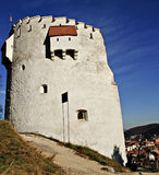 Brasov's white tower. The White tower was built in 1494 on top of a rock.It's placed in Brasov's Old Town stock photography