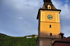 Brasov townhall with a sign on the hill Stock Photos