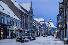 Brasov, Transylvania, Romania - December 28, 2014: A view of one of the main streets in downtown Brasov. One of the main streets in Brasov, Romania, with old Stock Images