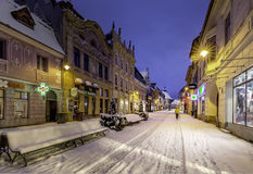 Brasov, Transylvania, Romania - December 28, 2014: A view of one of the main streets in downtown Brasov. Old houses on one of the main streets of the city of Stock Photos