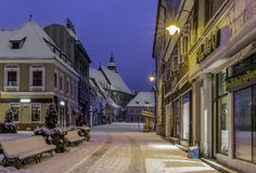Brasov, Transylvania, Romania - December 28, 2014: A view of one of the main streets in downtown Brasov. Old houses on one of the main streets of the city of Royalty Free Stock Photography
