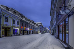Brasov, Transylvania, Romania - December 28, 2014: A view of one of the main streets in downtown Brasov. Old houses on one of the main streets of the city of Royalty Free Stock Photos