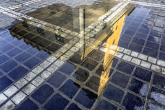 Brasov, Transylvania, Romania - Fall, 2014: A view of the city square building in a reflection after the rain Stock Image