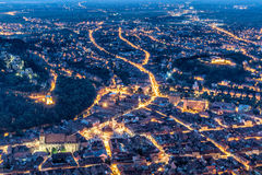 Brasov, Transylvania, Romania - Fall, 2014: A view of the city at sunset from Tampa Mountain Royalty Free Stock Images