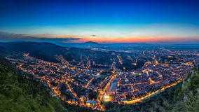 Brasov, Transylvania, Romania - Fall, 2014: A view of the city at sunset from Tampa mountain Royalty Free Stock Photography