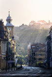 Brasov, Transylvania, Romania - July 28, 2015: A view of one of the main streets in downtown Brasov. Going down from the city square and passing by a Catholic Stock Image