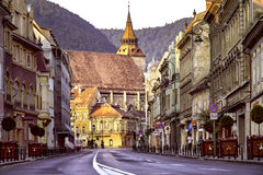 Brasov, Transylvania, Romania - July 28, 2015: A view of one of the main streets in downtown Brasov. Going up towards the city square where you can find the Stock Image