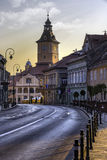 Brasov, Transylvania, Romania - July 28, 2015: A view of one of the main streets in downtown Brasov with important buildings. Brasov, Transylvania, Romania Royalty Free Stock Photography