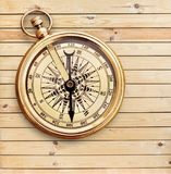 Brass antique compass  on background. Antique brass compass background object decorative equipment Royalty Free Stock Images