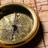 Brass antique compass close-up view. Antique brass compass background object decorative equipment Royalty Free Stock Photography