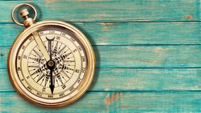 Brass antique compass on wooden background. Antique brass compass background object decorative equipment Stock Images