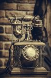 Brass antique vintage analog telephone Royalty Free Stock Photo