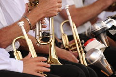 Brass Band. Photograph of trumpets being held,shot is taken at lap level in natural light Royalty Free Stock Photography