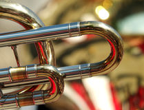 Brass band abstract photo. Abstract backgrounds of brass band instruments with details of a trombone in the foreground stock photography