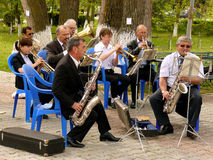 Brass band. BUDYONNOVSK, STAVROPOL REGION, RUSSIA - MAY 1, 2014: municipal brass band on the Labor Day celebration, on 1st of May 2014, in Budyonnovsk, Russia Royalty Free Stock Images