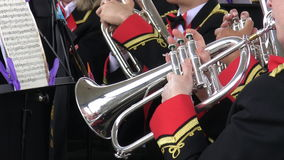 Brass band instruments. Close up of brass band instruments played by musicians in uniform during performance stock video